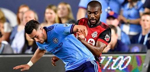 Jack Harrison of New York City FC is defended