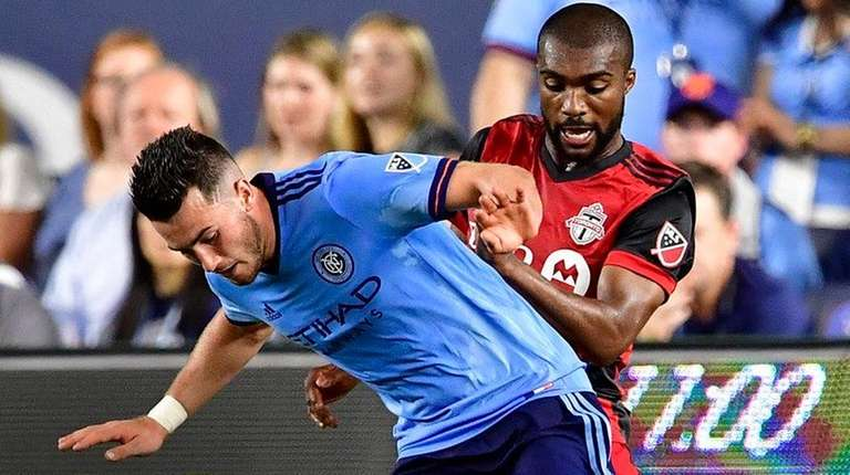 Jack Harrisonof New York City FC is defended