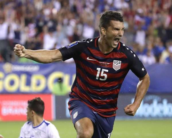 The United States' Eric Lichaj reacts after scoring