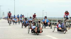 Dozens of wounded veterans ride over the Robert