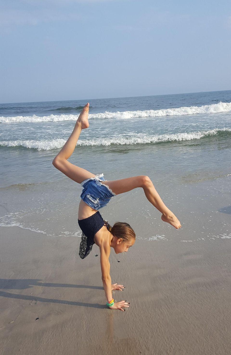 Sophia's handstand on the beach at Long Beach