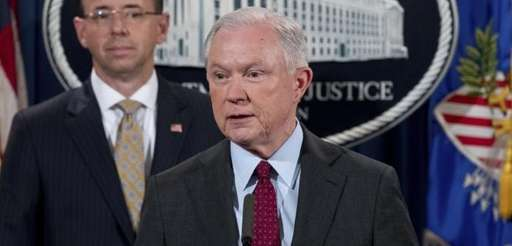 Attorney General Jeff Sessions accompanied by Deputy Attorney