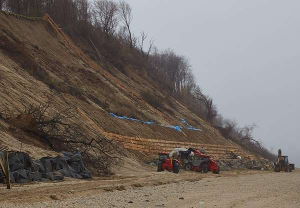 Workers shore up an area of the shoreline