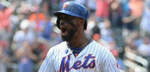 Mets shortstop Jose Reyes reacts after he hits