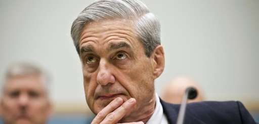 Robert Mueller listens as he testifies on Capitol