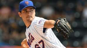 Mets pitcher Seth Lugo throws against the Cardinals