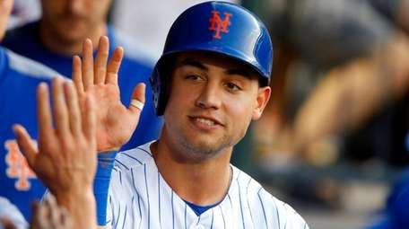 Michael Conforto of the Mets celebrates in the