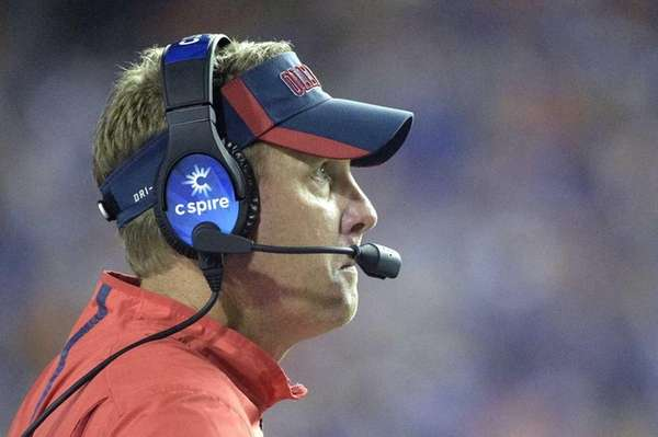 Mississippi head coach Hugh Freeze watches from the