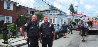 NYPD Officers John Maderik, left, of Bellerose, Queens,