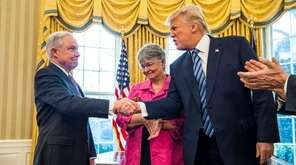 Jeff Sessions accepts congratulations from President Donald Trump