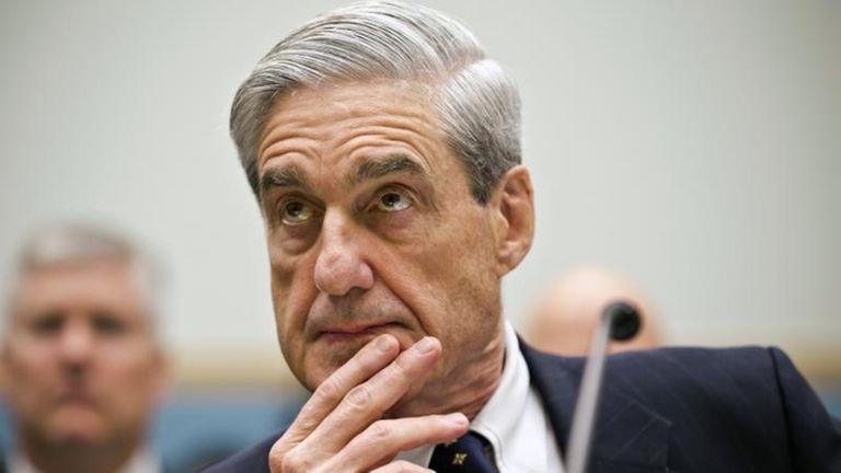 Robert Mueller listens as he testifies on Capitol
