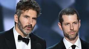 David Benioff, left, and D.B. Weiss accept the