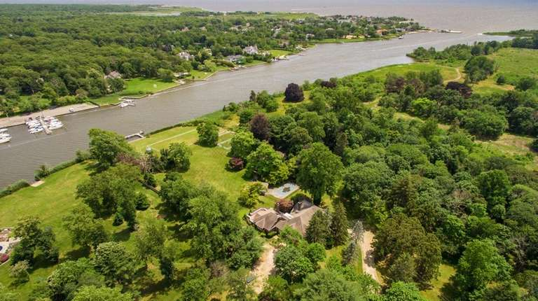 The site fronts Champlin Creek and abuts the