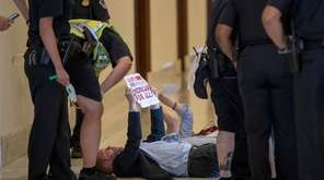 Activists are surrounded by U.S. Capitol Police as