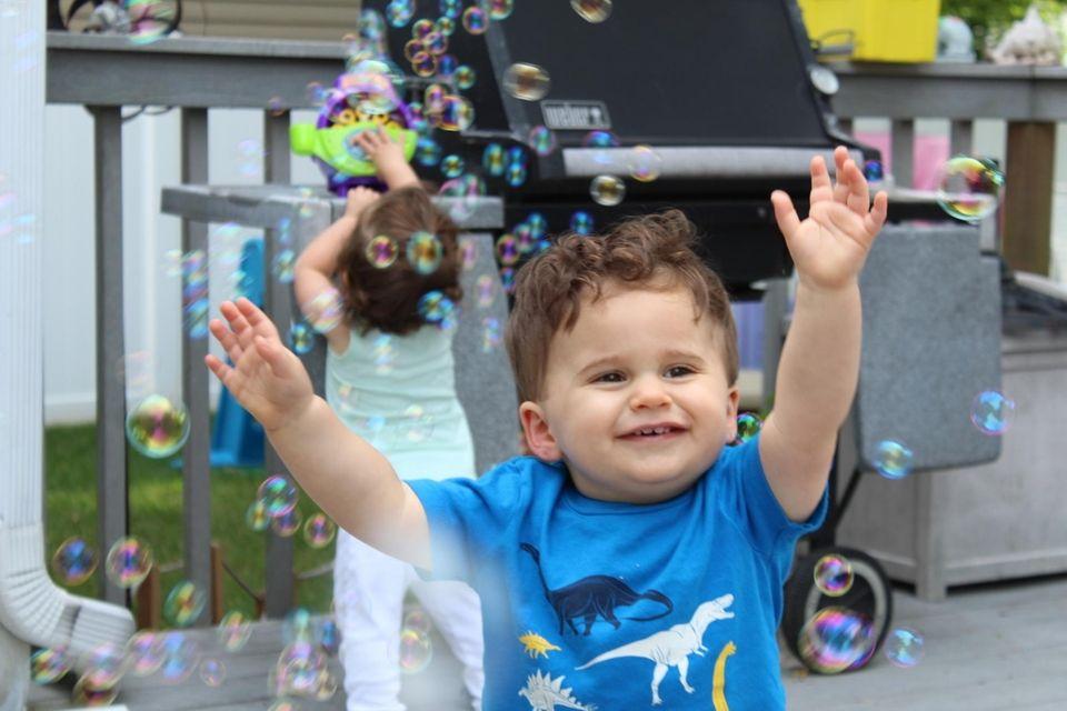 Nicholas & Julianna Biondo enjoying backyard bubble fun