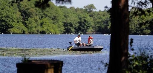 Paddlers enjoy Knapps Lake at Brookwood Hall park