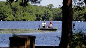 Paddlers enjoy Knapps Lake at Brookwood Hall park