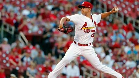 St. Louis Cardinals starting pitcher Marco Gonzales throws