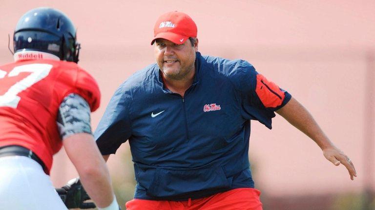 Mississippi offensive line coach Matt Luke works on