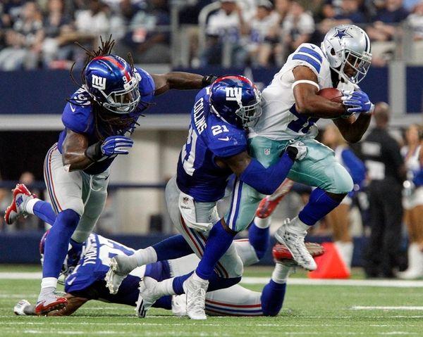 Dallas Cowboys linebacker James Morris is brought down