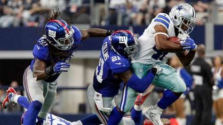 Dallas Cowboys linebacker James Morris is brought down