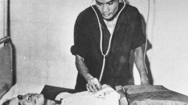 John McCain in a Hanoi hospital during the