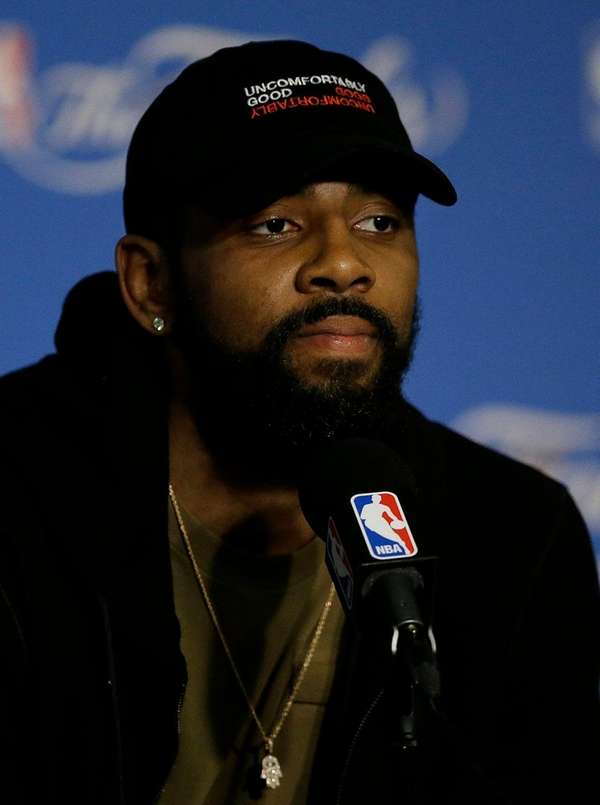 Cleveland Cavaliers guard Kyrie Irving speaks at a