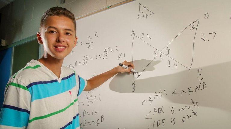Benjamin Catalfo, 16, of East Setauket, demonstrates