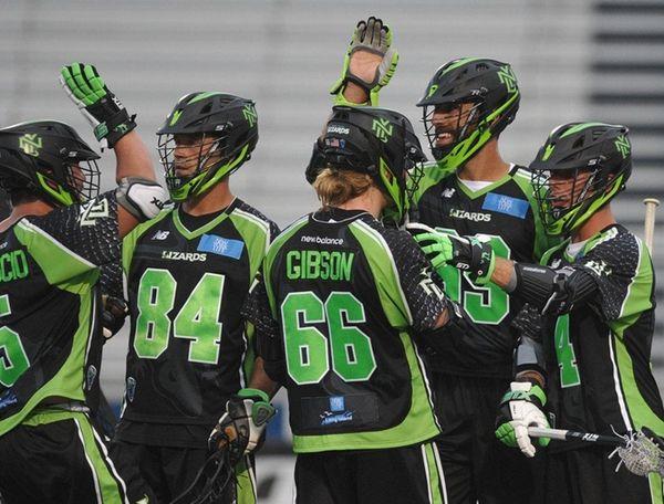 New York Lizards teammates celebrate after a goal
