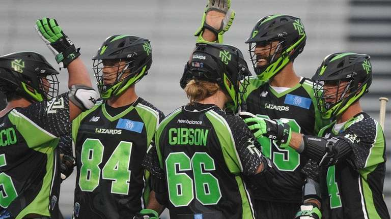 New York Lizards teammates celebrate after a goal