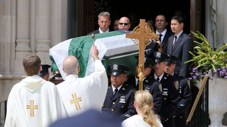 NYPD officers carry the casket of Robert Summers