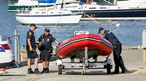 Suffolk County Police inspect a rescue boat at