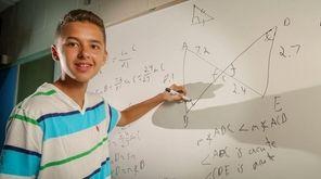 Benjamin Catalfo, 16, of Setauket, demonstrates an error