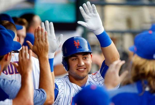 Michael Confortoof the Mets celebrates his home run