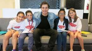 Actor Jake T. Austin with Kidsday reporters, from