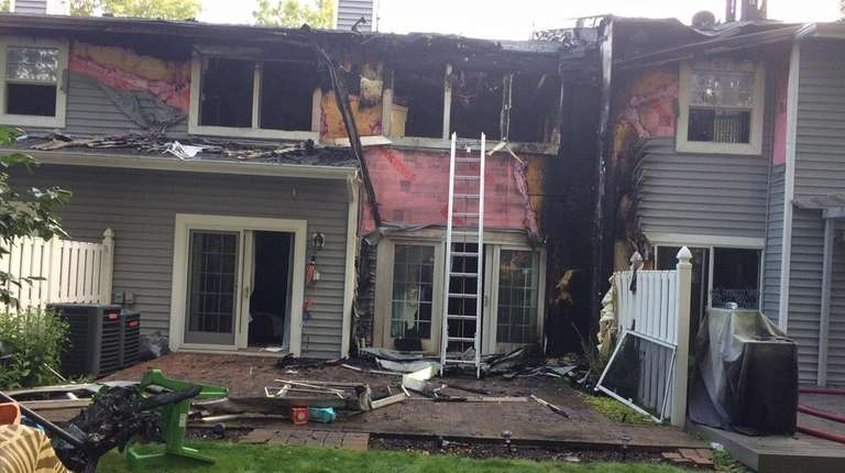 A fire that began at a Holbrook condominium