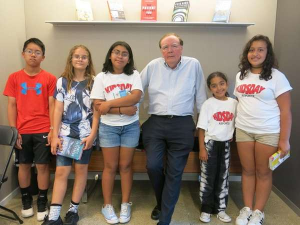 James Patterson with Kidsday reporters, from left: Adam