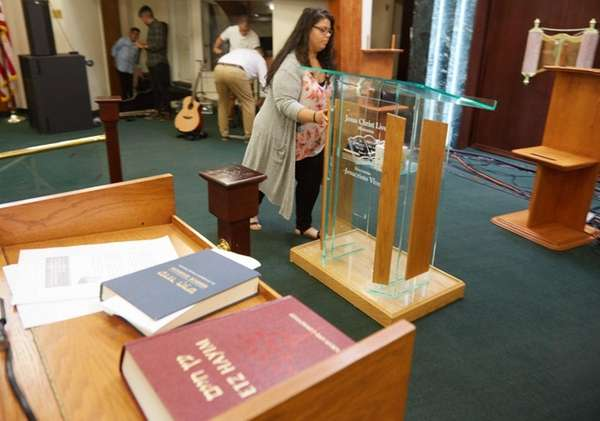 Aixalee Villatoro of Brentwood moves the pulpit after