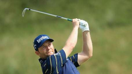 Branden Grace of South Africa hits an approach
