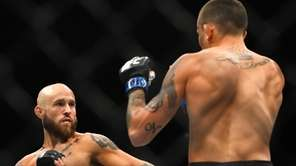 Bantamweights Brian Kelleher and Marlon Vera fight during