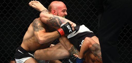 Bantamweights Brian Kelleher and Marlon Vera fight during