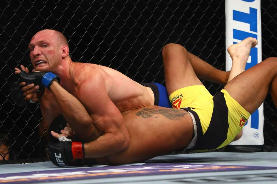 Welterweights Ryan LaFlare and Alex Oliveira fight during