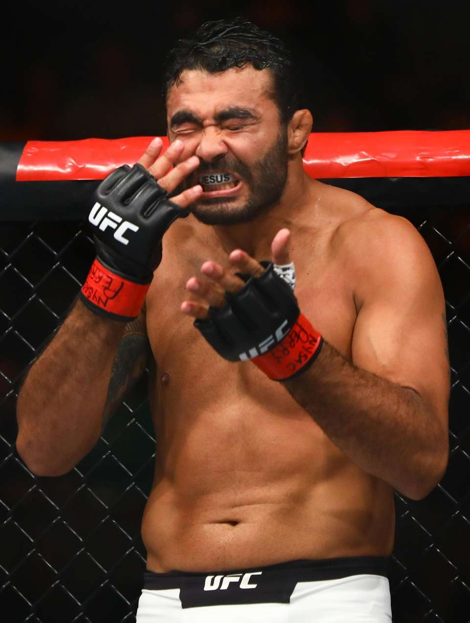 Middleweight Rafael Natal smacks his face before his