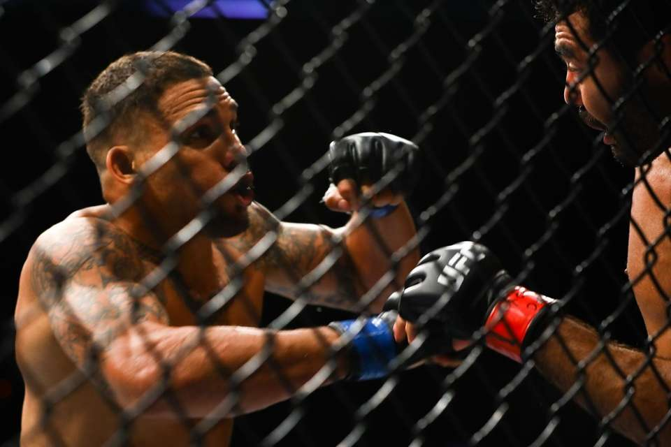 Middleweights Rafael Natal and Eryk Anders fight during