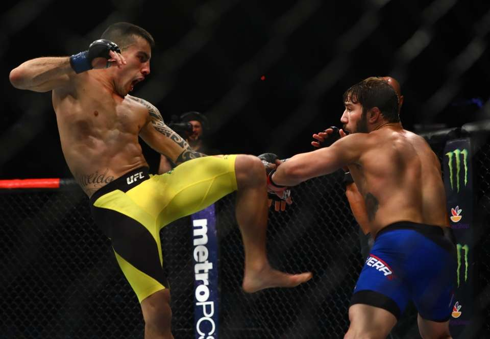Bantamweights Jimmie Rivera and Thomas Almeida fight during