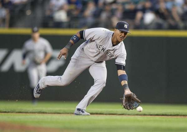 Starlin Castro of the Yankees fields a ball