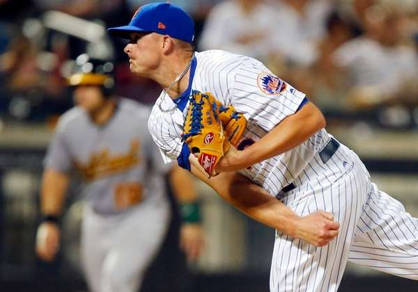 Addison Reed of theMets pitches against the A's