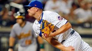Addison Reed of the Mets pitches against the  A's