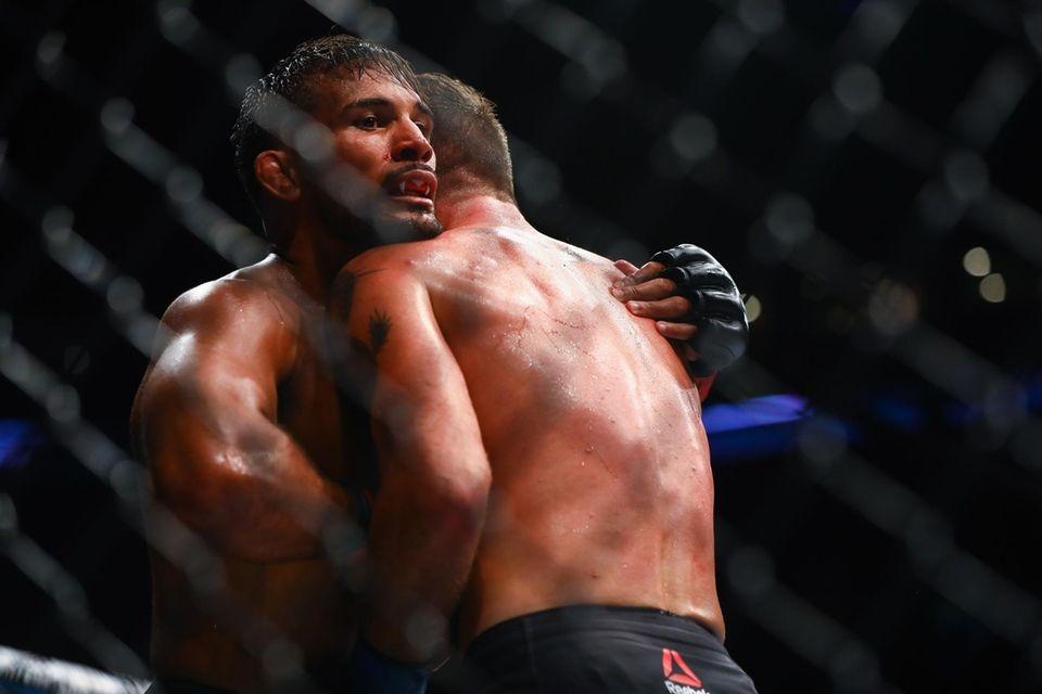 Featherweights Dennis Bermudez and Darren Elkins fight during