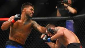 Featherweights Dennis Bermudez and Darren Elkins fight during